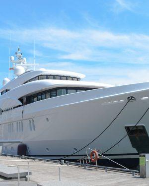 large white yacht docked