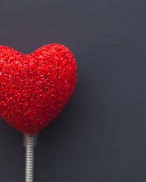 Big Red Heart Shape on Dark Background