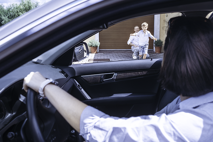 Co-parenting Ex-Husband Father Watches Young Son Run To Ex-Wife Mother Waiting in Car for Pickup - Horizontal Photo