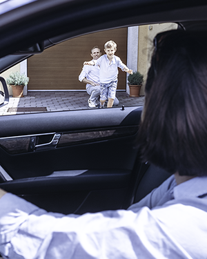 Co-parenting Ex-Husband Father Watches Young Son Run To Ex-Wife Mother Waiting in Car for Pickup - Vertical Photo