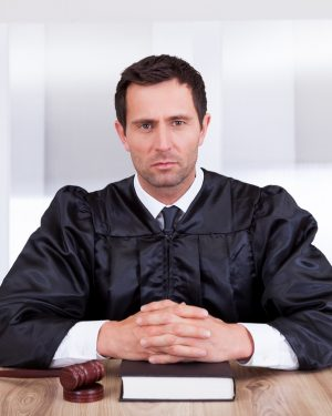 Judge sitting at desk