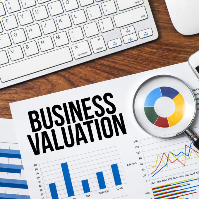 "Business document displaying graphs and charts with ""Business Valuations"" at the top"